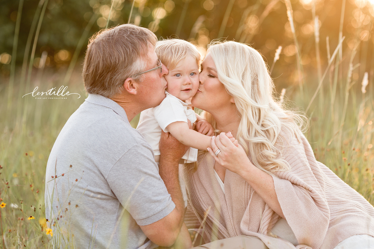 Parents kissing baby son taken by a Houston Baby Photographer