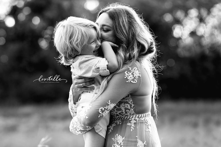 Mom kissing her child