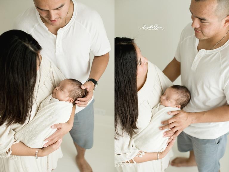 Parents hold their newborn baby