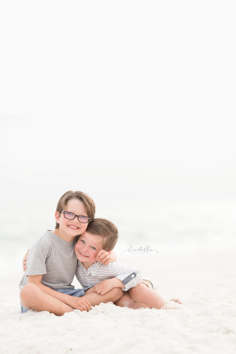 Brothers hugging on a beach