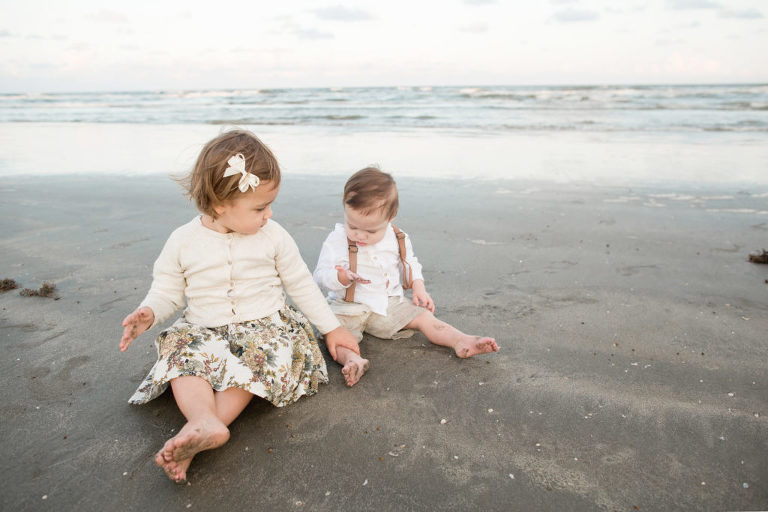 Children playing on a beach taken by a Houston Family Photographer