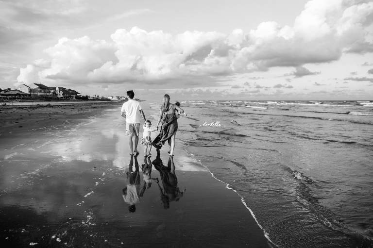 A family strolls along the beach