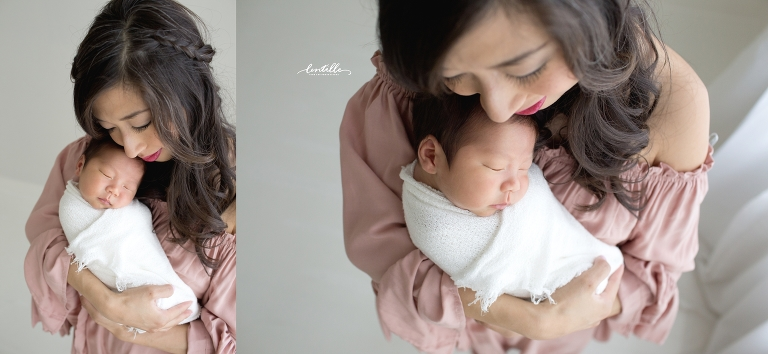 Baby sleeps on mom's chest