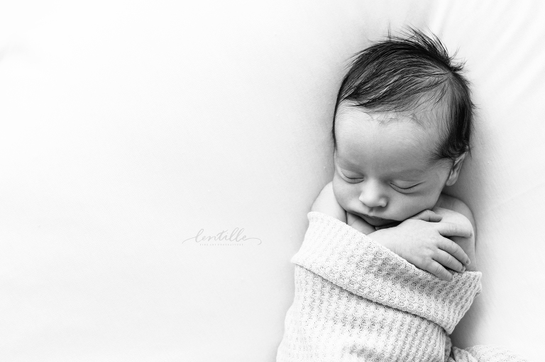 Newborn baby sleeping during a studio session in Houston, Texas   Lentille Photography