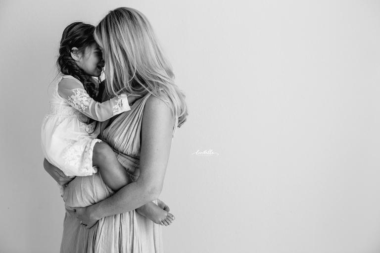 A mother hugs her daughter