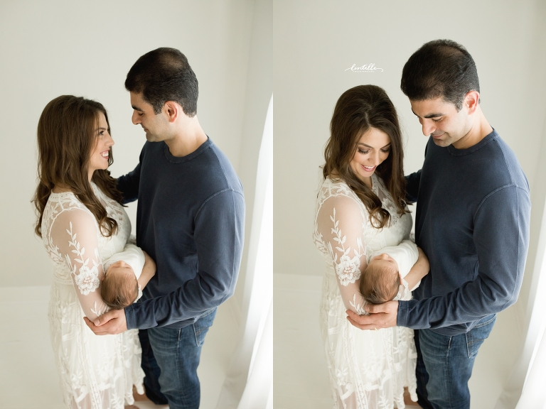 A couple holds each other and their baby, captured by Houston Newborn Photographer, Lentille Photography