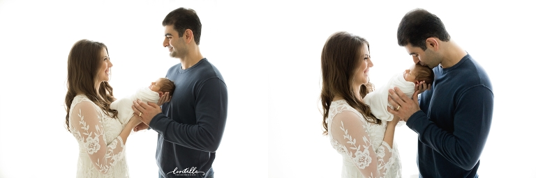 A couple hold their baby, captured by Lentille Photography, a photographer focusing on Houston Newborn Photography