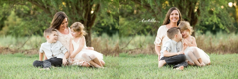 A family sits in a field, captured by Lentille Photography, a Houston Family Photographer