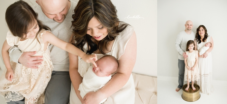 A family stands with their newborn, captured by Lentille Photography, a Houston Newborn Photographer