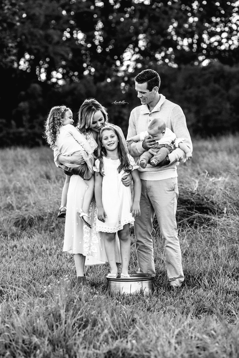 A girl stands on a bucket | Lentille Photography | Houston Family Photographer