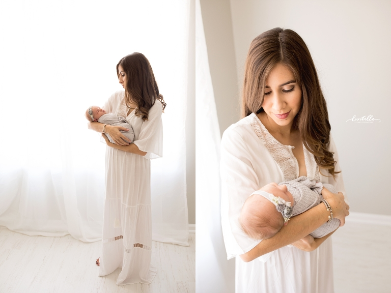 A mom holds her baby   Lentille Photography   Newborn Photographer in Houston