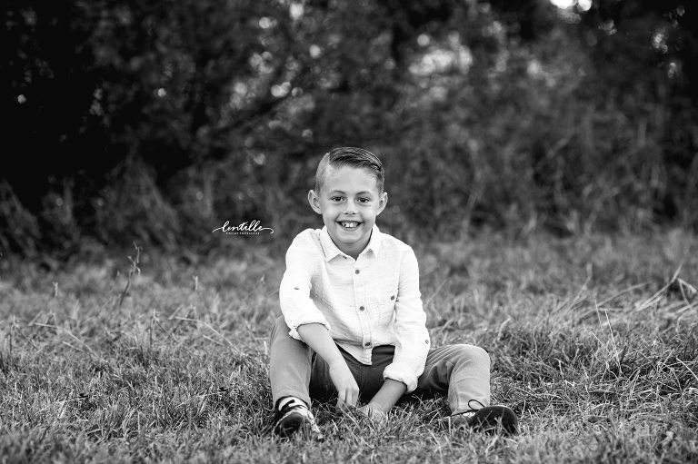 A boy sits on the grass | Lentille Photography | Family Photographer in Houston