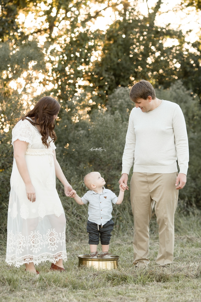 A boy holds hands | Family Photographer in Houston | Lentille Photography
