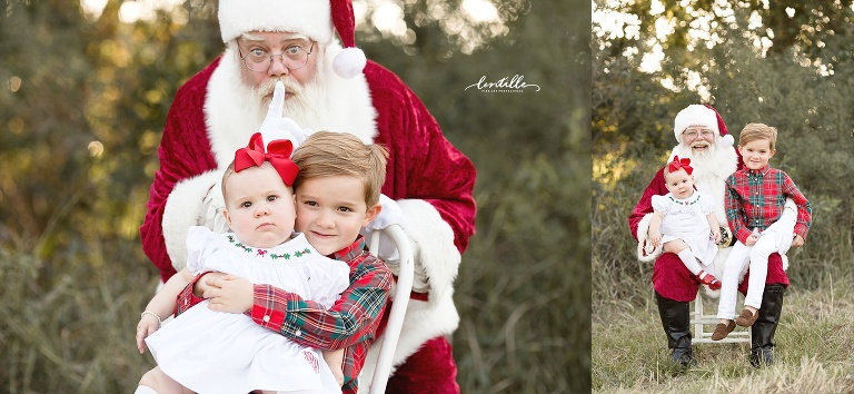 A brother hugs his sister in front of Santa  | Lentille Photography | Best Houston Outdoor Santa Sessions
