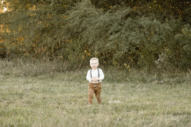 A boy stands in a field | Lentille Photography | Family Photographer in Houston