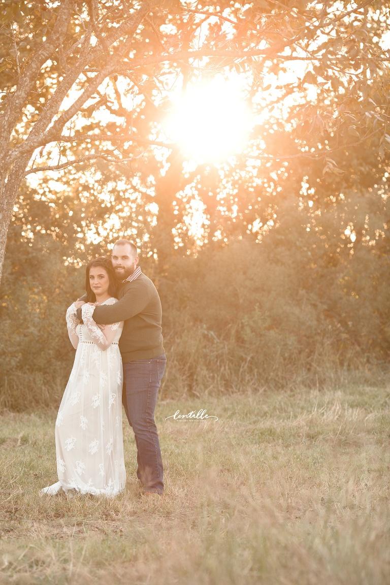 A man gives his love a bear hug    Lentille Photography   Photographer in Houston