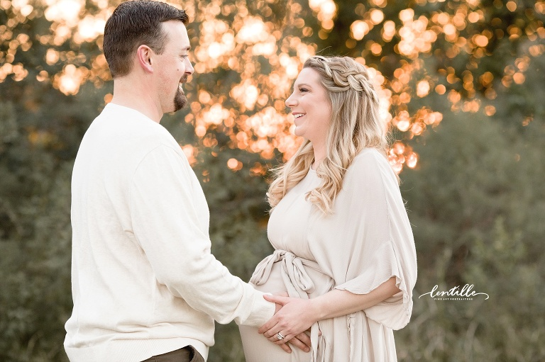 A couple smile | Lentille Photography | Houston Maternity Photographer
