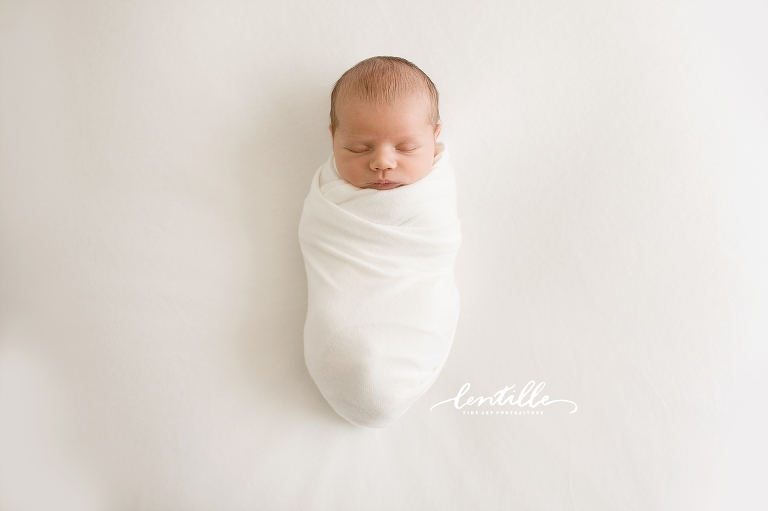 A newborn naps  | Lentille Photography | Captured in a studio full of light