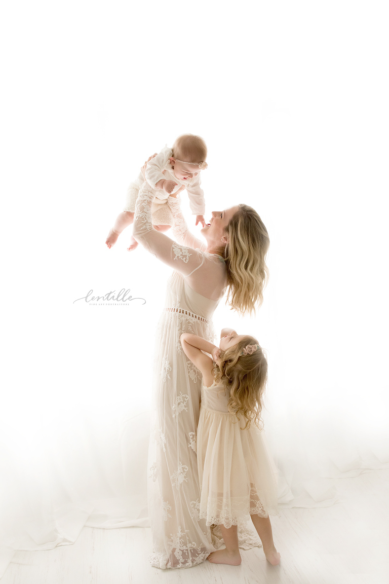 A mama holds her babies with Love that flows | Lentille Photography