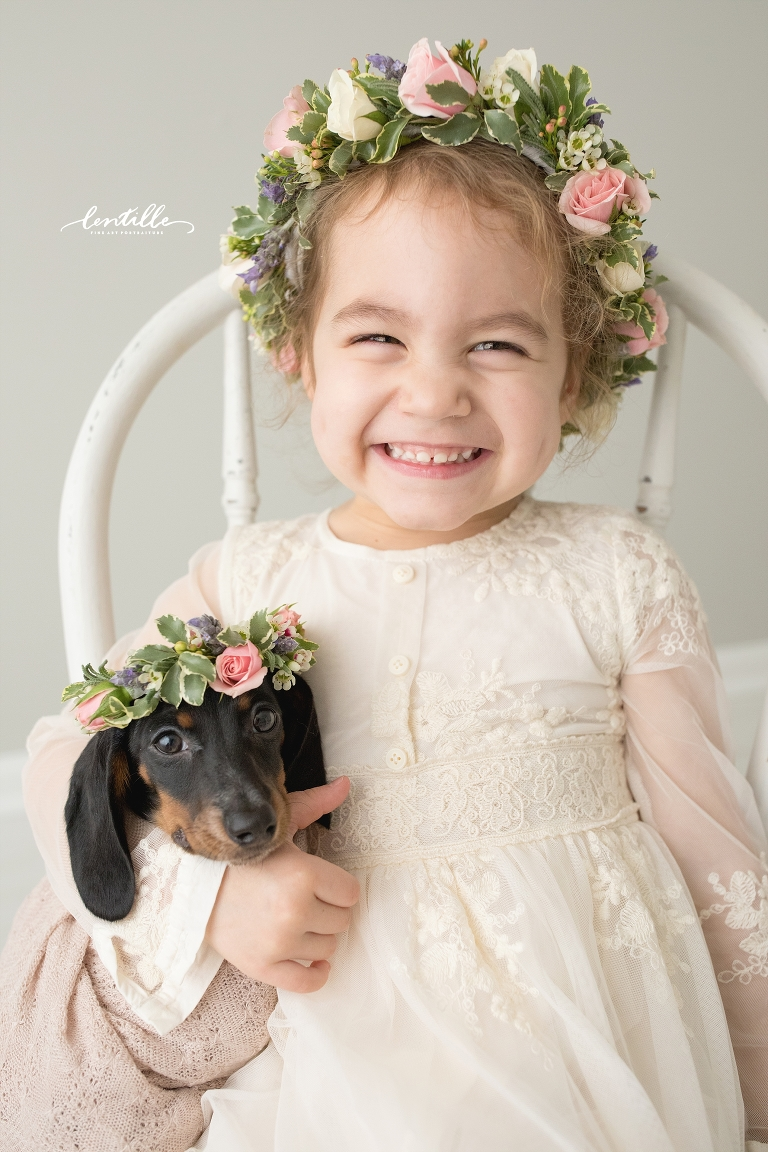 A little girl is proud of her new puppy | Lentille Photography | Darling Dachshund