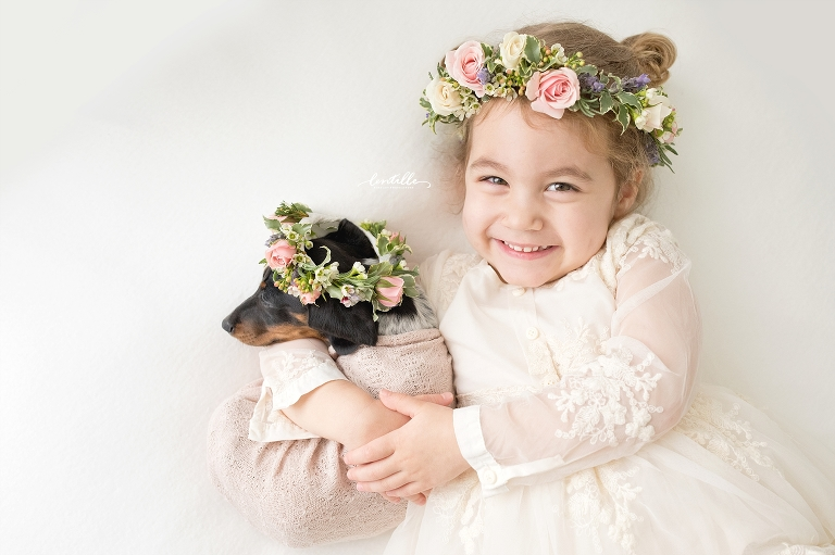 A girl proudly hugs her puppy | Lentille Photography | Darling Dachshund