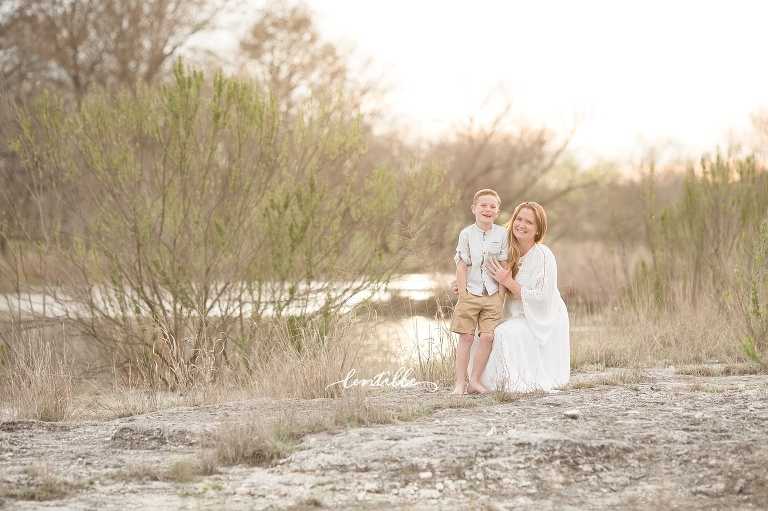 A mom crouches beside her son | Motherhood Sessions