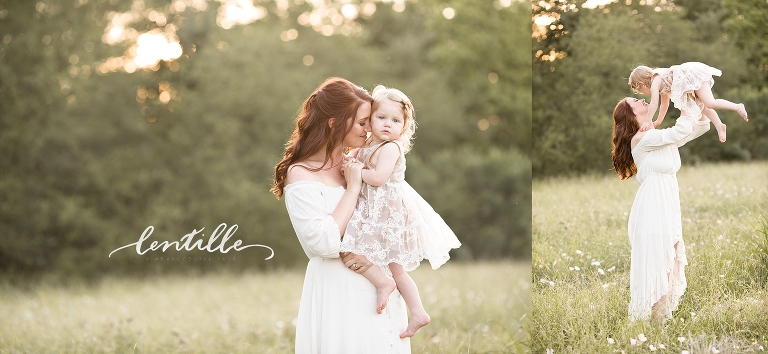 A mom holds her daughter close as they enjoy a sunset.