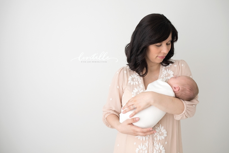 A mom holds her baby for a Newborn Baby Photography In Houston session.