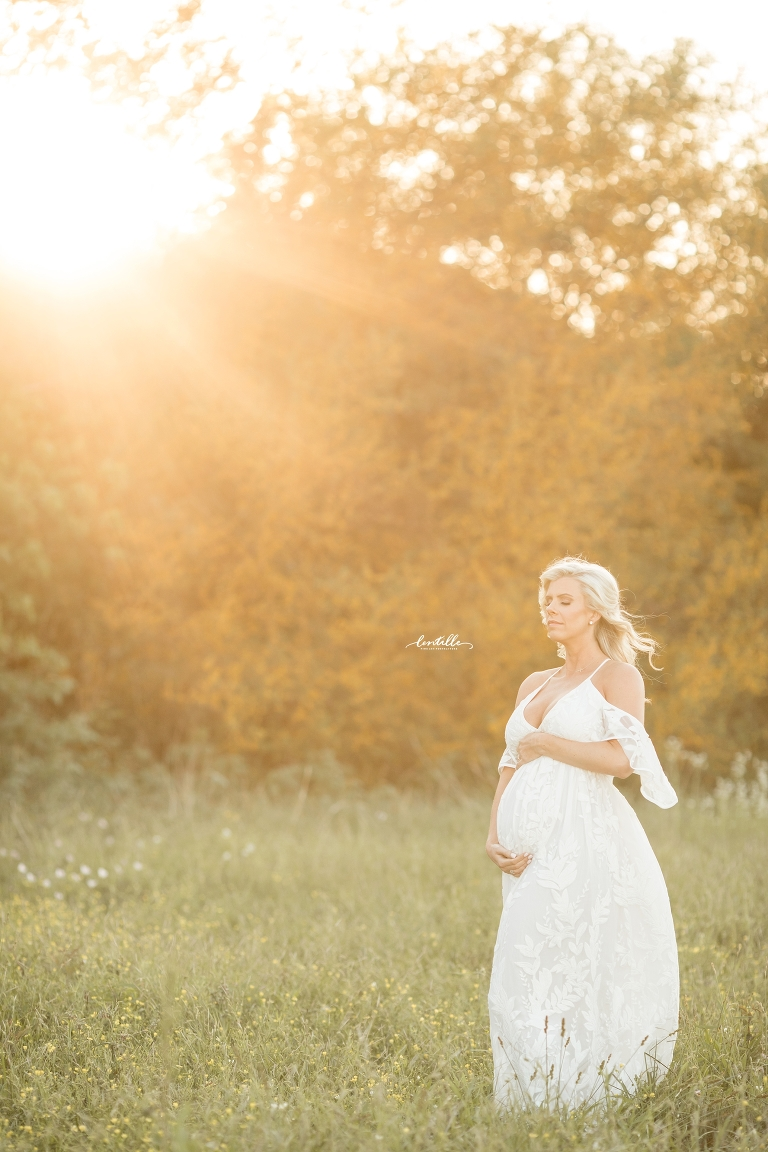 wildflowers in the field maternity session